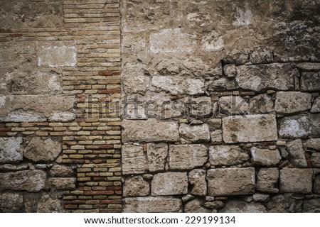 textured stone wall, Spanish city of Valencia, Mediterranean architecture - stock photo
