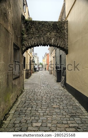 Textured stoned road of medieval backstreet in Cork town, Ireland - stock photo