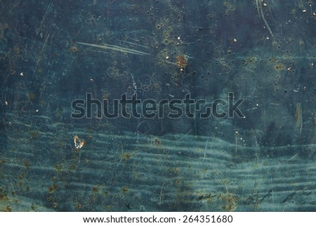 textured turquoise green and dark blue colored rusty metal background - stock photo