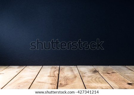 textured wooden table with black background - stock photo