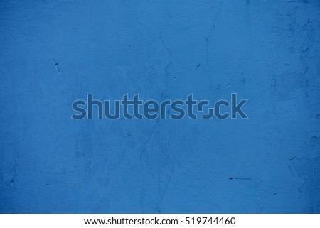 Textures on the blue wall, for background. Grungy blue concrete wall background. Background from high detailed fragment stone wall. Cement texture. Blue concrete wall.