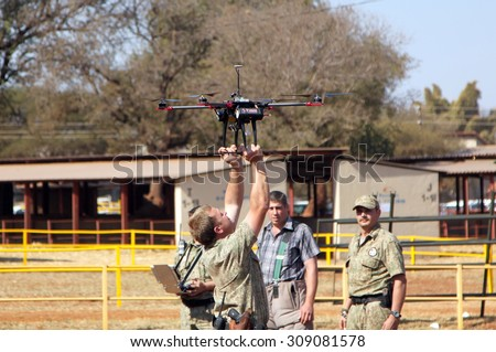 THABAZIMBI, SOUTH AFRICA - August 1:  Farm Community Security displaying drone with camera to trace thieves and attackers at the Thabazimbi Show, on August 1, 2014 at Thabazimbi, South Africa.