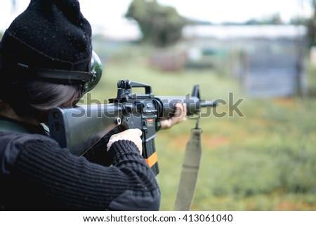 Thai air soft gun player in combat suit - stock photo