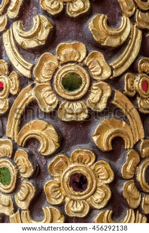 Thai ancient gold cement stucco and color glass in temple