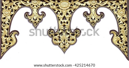 Thai ancient gold plaster stucco decorative gate  in front of thai temple. - stock photo