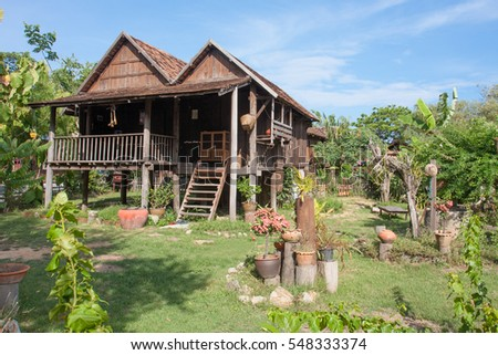 Thai ancient style house designed with high platform to let the wind flow for ventilation in summer and avoid water flooding in rainy season