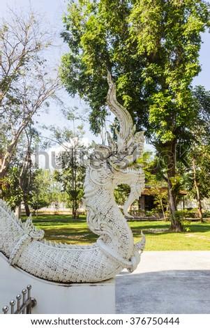 Thai Art, Single white Naka (giant snake) head statue at Thai Buddhist church with deep  depth of field, Tha Sak temple, Phuket province, South of Thailand - stock photo