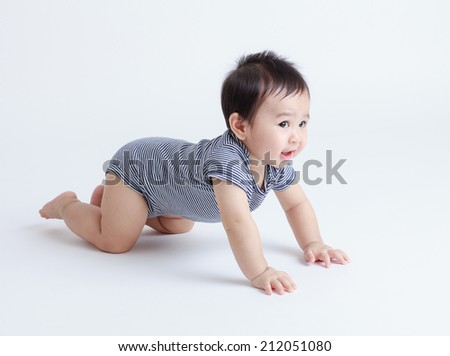 Thai baby crawling isolated