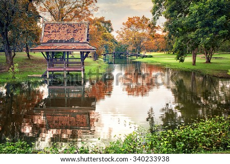 Thai beautiful garden landscape  on the banks of the pond.Ancient pool on Auytthaya territory.Thailand - stock photo