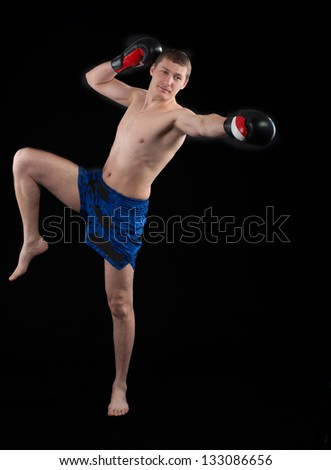Thai boxer on dark background