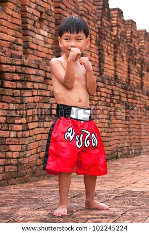 "Thai boxing-letters on the pants not Contains potential trademark or copyright infringement but Thai language is name ""muay thai or Thai boxing"" - stock photo"