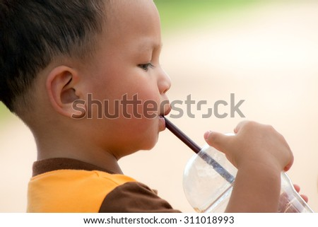 Thai boy drinking water