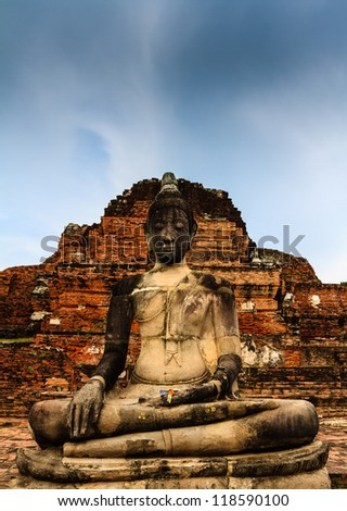 Thai Buddha statue in Wat Mahathad , Ayutthaya Thailand ancient capital of Thailand. This is traditional and generic style in Thailand. No any trademark or restrict matter in this photo. - stock photo