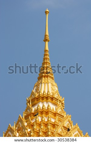 Thai Buddhist temple in Kanchanaburi, Thailand. Golden architecture.