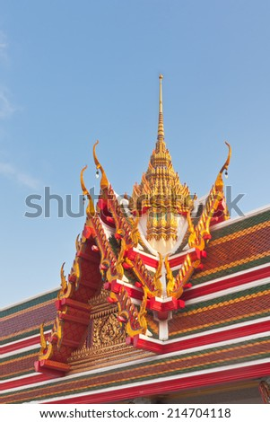 Thai Buddhist temple roof gable with tiered and carved apex