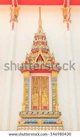 Thai Buddhist temple window sculpture - stock photo