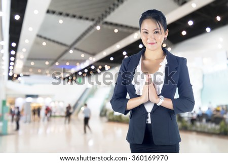 Thai business women in a traditional welcoming gesture, - stock photo