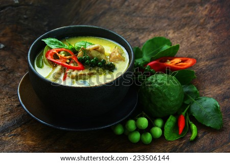 Thai chicken green curry with old wooden background - stock photo