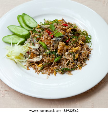 thai Chili paste fried rice with  Mackerel,mango,egg and cucumber . - stock photo