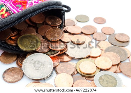 Thai coin dimes, dollar Hong Kong coin and Japanese Yen coin. Wallet and coin on white background.