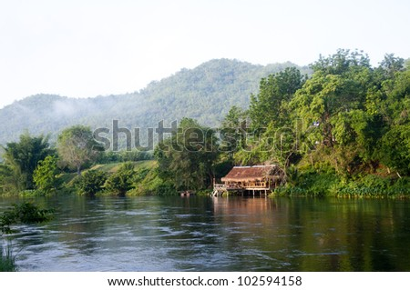 Thai cottage at the riverside of Thailand. - stock photo
