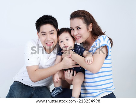 Thai couple family and son smiling with happily isolated