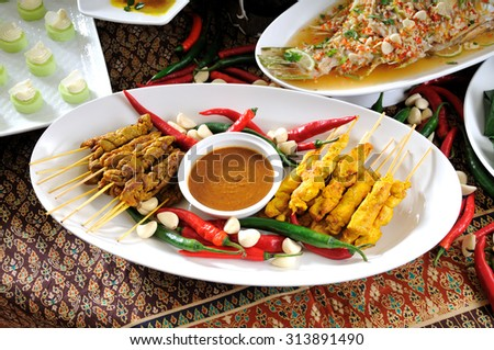 thai cuisine,Chicken Satay,Beef Satay. Malaysian chicken satay with delicious peanut sauce, one of famous local dishes. - stock photo