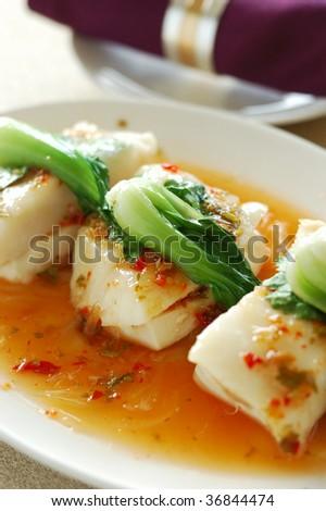 Thai cuisine - hot and sour lemon fish - stock photo