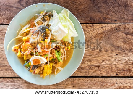 """Thai cuisine spicy delicious : """" SOM TAM """" on wood table - stock photo"""