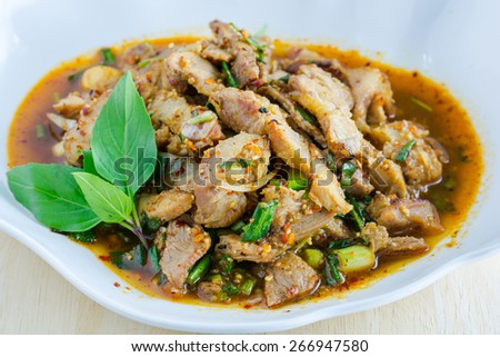 Thai cuisine spicy pork salad, Moo Nam Tok. - stock photo