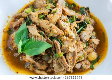 Thai cuisine spicy pork salad, Moo Nam Tok. - stock photo