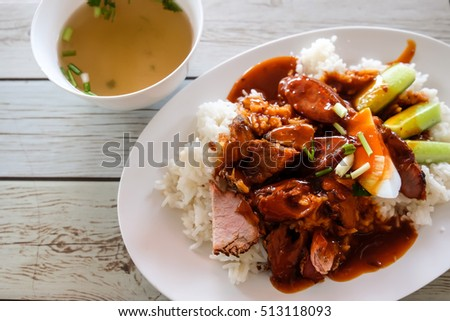 Thai cuisine, Top view food, Rice topping red pork barbecue sauce with soup