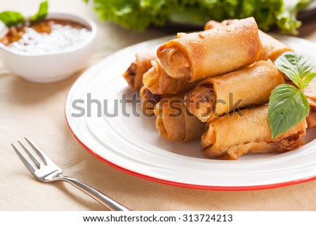 thai deep fried spring roll pile on plate