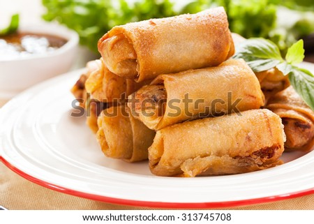 thai deep fried spring roll pile on plate - stock photo