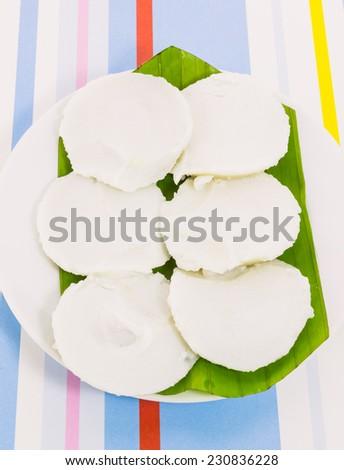 "Thai dessert call "" Kanom thuay"" (Coconut milk custard in small porcelain cup)  - stock photo"