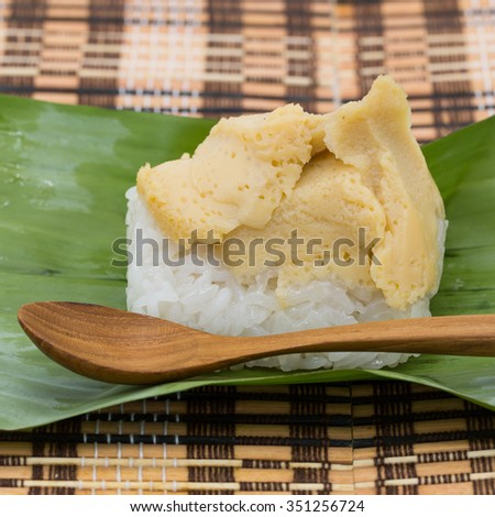 Thai dessert egg custard with sticky rice on banana leaf - stock photo
