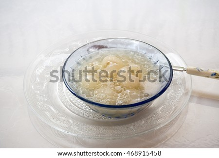 Thai dessert of sago and longan with coconut milk