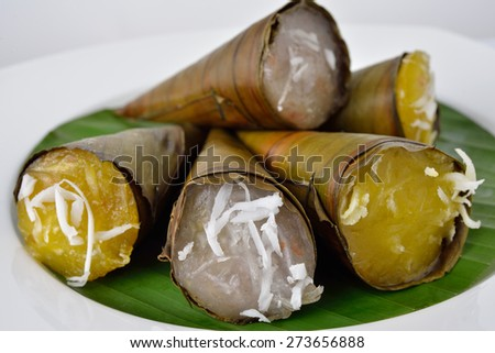 Thai dessert steam-minced pumpkins and taro with shredded coconut in cone - stock photo