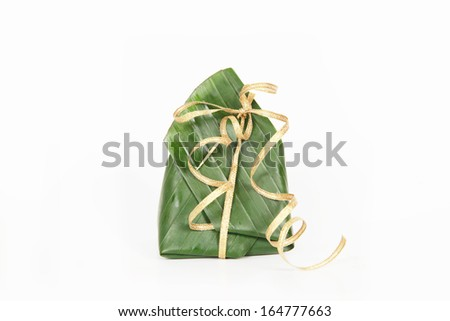 thai dessert, Sticky rice with steamed custard, wrapped in banana leave and gold ribbon.