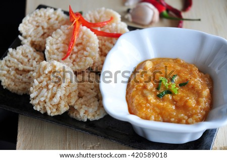 Thai dish dipping sauce with rice cracker on tray - stock photo