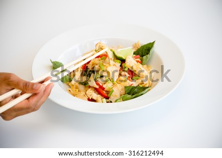 Thai dish of chicken Pad Kee Mao with Bell Pepper and Thai Basil  - stock photo
