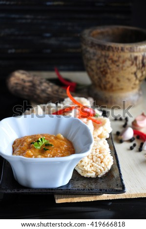 Thai dish rice cracker with dip sauce on plate - stock photo