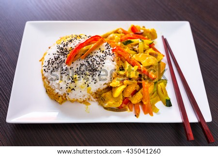 Thai dish with chicken in green curry souce and rice - stock photo