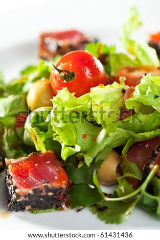 Thai Dishes - Salad with Sliced Tuna in Sesame, Cherry Tomato and Olives - stock photo