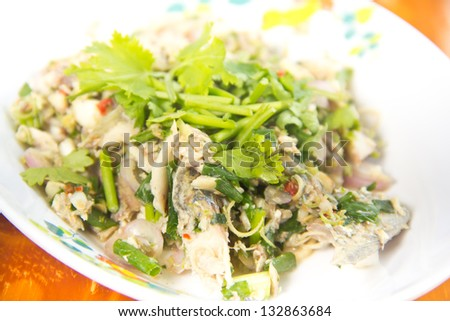 Thai dressed spicy salad with tuna, green herbs and vegetable