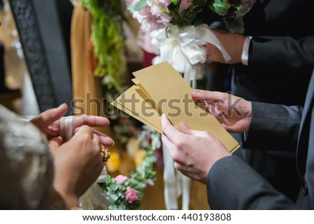 Thai Engagement Traditional, Wedding Ceremony, Cultural wedding Thai. Groom have to send gold packet to bridesmaid to entrance wedding ceremony. Send packets of money from hand to hand. select focus  - stock photo