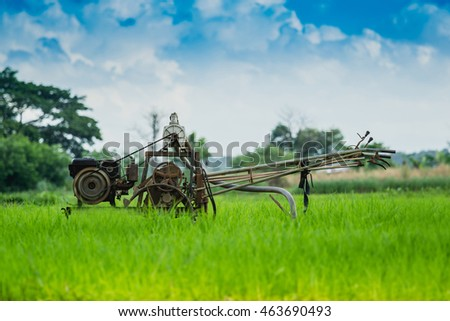 Thai Farmer using old tiller tractor Pumping water from underground into the fields.