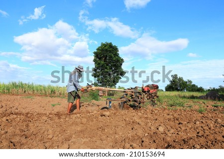 Thai Farmer using Walking Tractors for Cultivated Soil for Prepare Plantation in Thailand. - stock photo