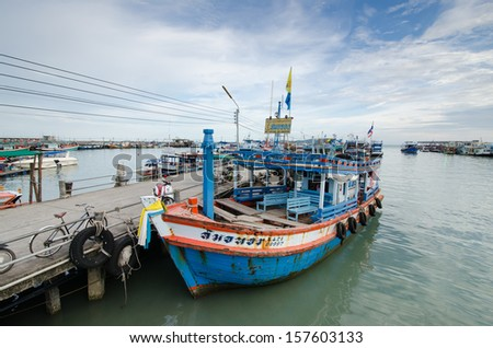 Thai fishing boat is sitting at sea port used as a vehicle for transporting people to island
