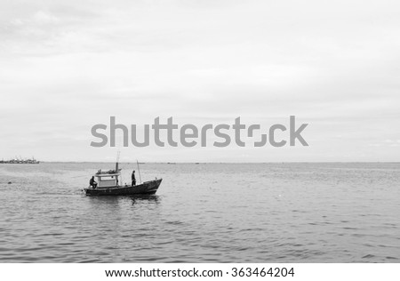 Thai fishing boat sailing to the sea with black and white background